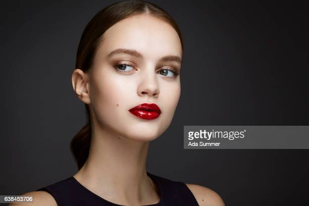 young beautiful woman with red glossy lips - menschliches gesicht stock pictures, royalty-free photos & images