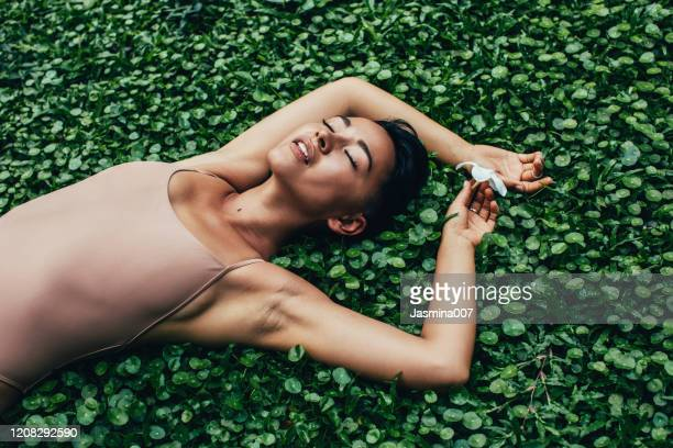 young beautiful woman with tropical plants - fashion model stock pictures, royalty-free photos & images