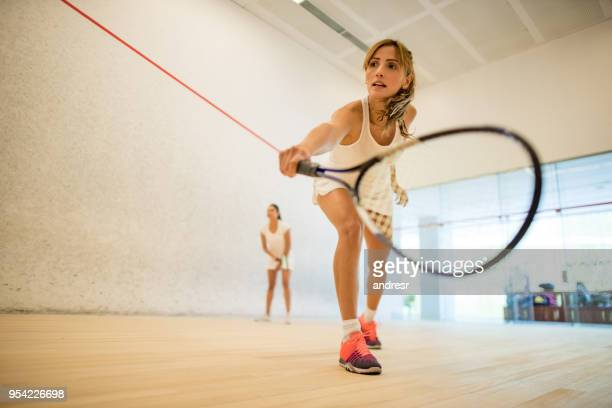 young beautiful women playing squash - squash sport stock pictures, royalty-free photos & images