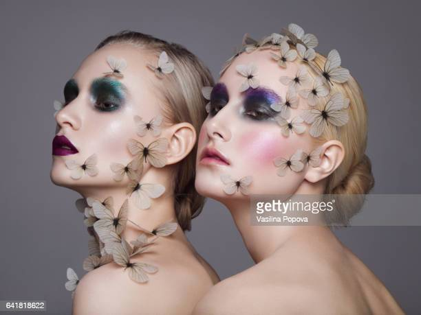 Young beautiful women with butterflies on there face and neck