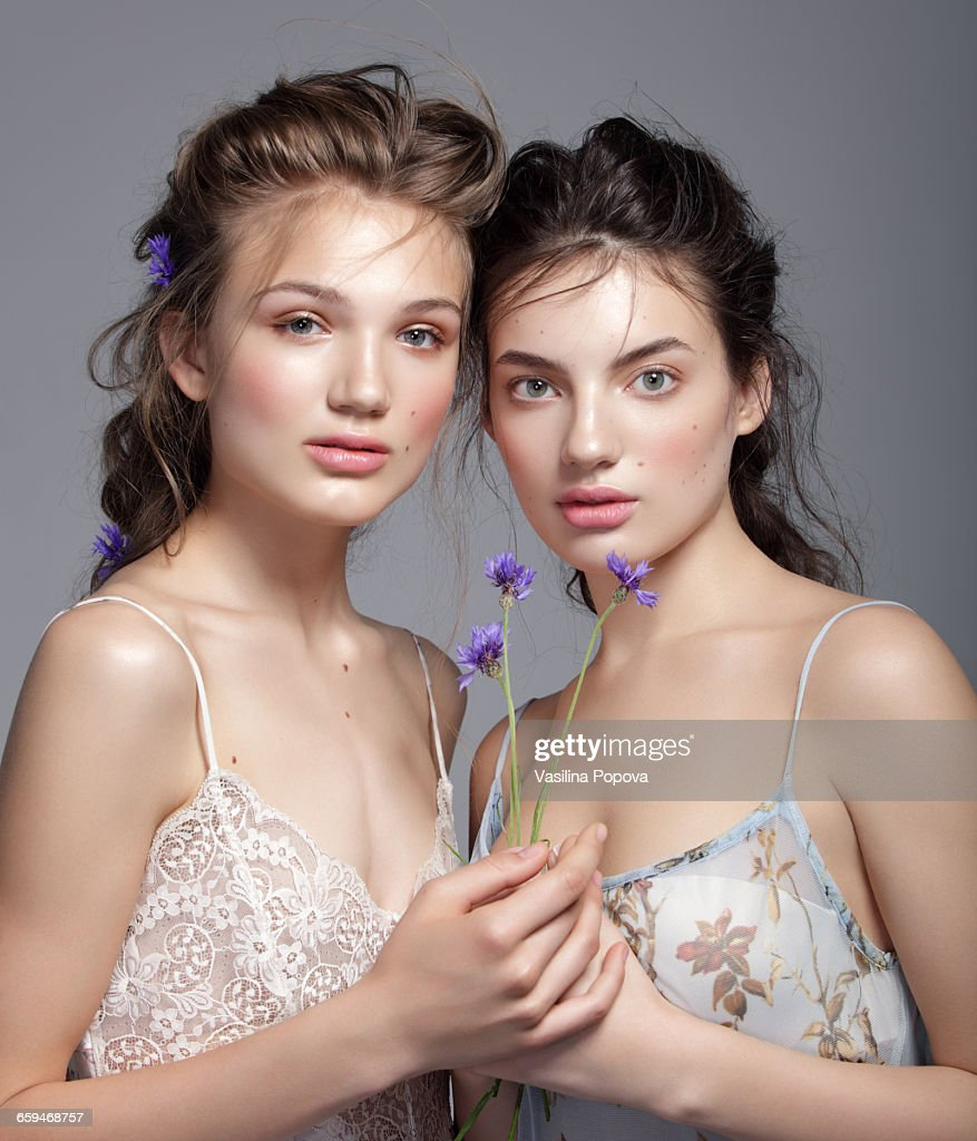 Young beautiful women with flowers stock photo getty images young beautiful women with flowers stock photo izmirmasajfo Image collections