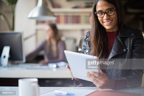 Young beautiful's business woman portrait at her desk