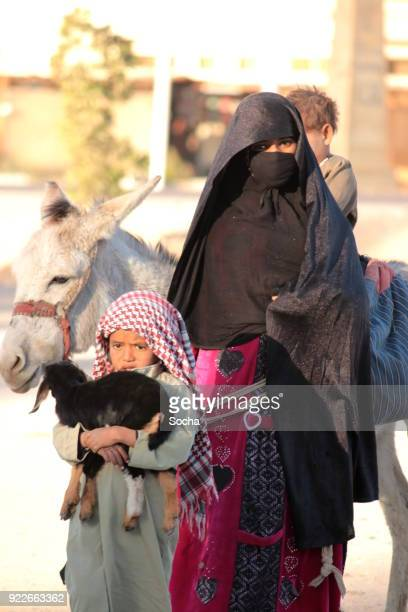 Young bedouin women with children from Bedouin village in Sahara desert, Egypt