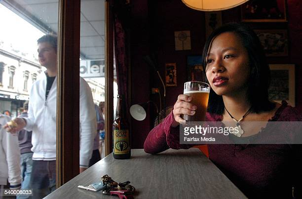 Young beer drinker Lisa Pham sinks another beer at Cafe Bebida on Smith St. Fitzroy. For story on the changing face on beer consumption. 17 June...