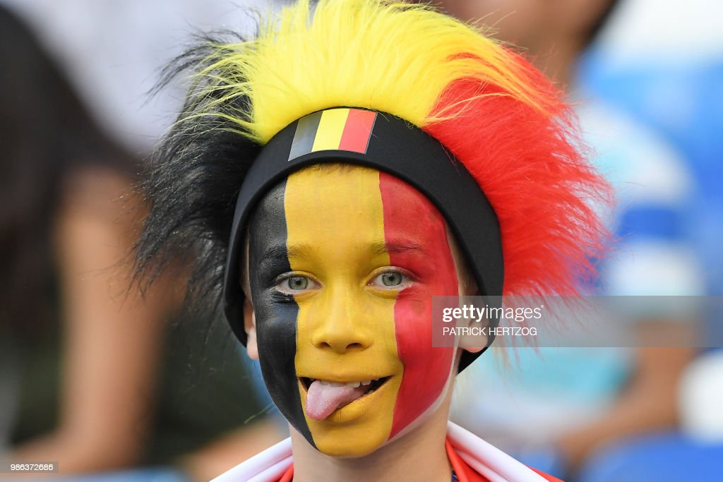 TOPSHOT - A young Belgium fan sticks out the tongue before the Russia 2018 World Cup Group G football match between England and Belgium at the Kaliningrad Stadium in Kaliningrad on June 28, 2018. (Photo by Patrick HERTZOG / AFP) / RESTRICTED