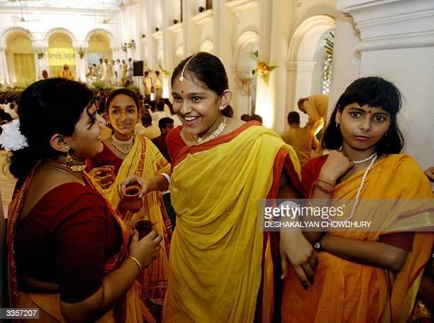 Young Bengali girls wearing traditional sarees celebrate the Bengali New Year at the historic palace of Sobhabazar in Calcutta 14 April 2004 On the...