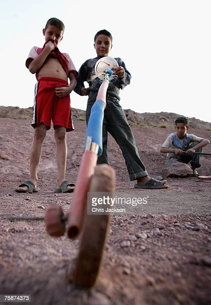 Young Berber boys play with a toy 'car' in the village of Ait Souka on July 25 2007 in Imlil district Morocco Ten year old Mustafa is lucky as he is...