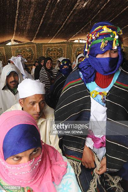 Young berber brides and grooms wait for their wedding ceremony in high Atlas Mountain the Berber village of Imilchil on September 23 2010 Once a year...