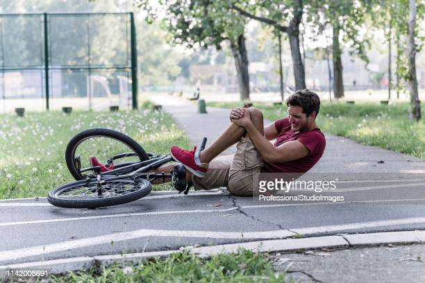 young biker suffered an accident - ecchi biker stock pictures, royalty-free photos & images