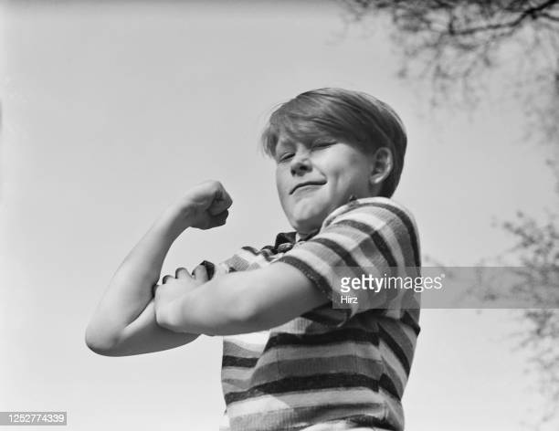 Young Billy Redfield shows off his flexed bicep in New York State May 1937