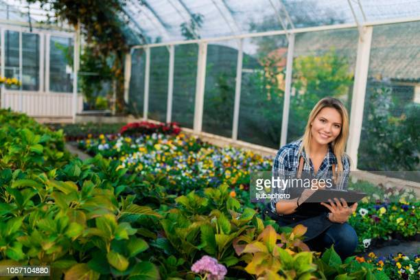 Young biotechnology woman engineer in greenhouse