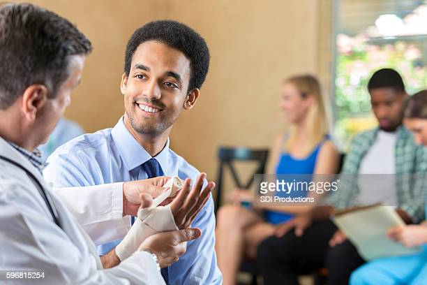Young biracial patient being examined by hospital doctor