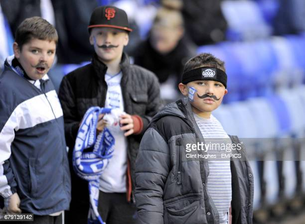 Young Birmingham City show their support for the Movember initiative with drawn on moustaches in the stands