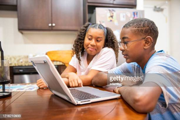 young black boy and girl homeschooling - adamkaz stock pictures, royalty-free photos & images