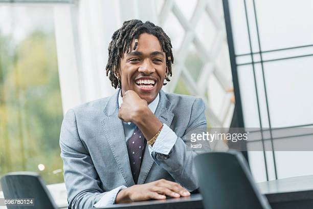 Young black businessman with dreadlocks