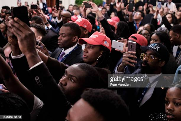 Young black conservative leaders from across the country take photos as US President Donald Trump speaks as part of the 2018 Young Black Leadership...