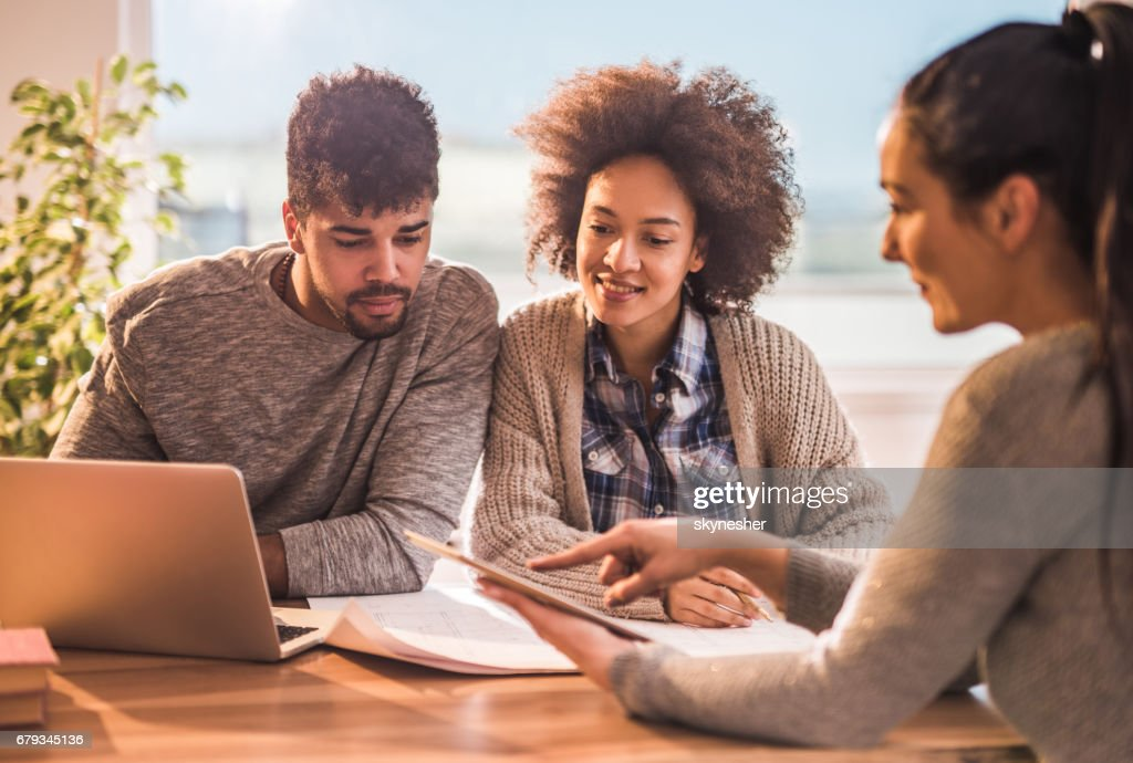 Young black couple having a meeting with their financial advisor. : Stock Photo