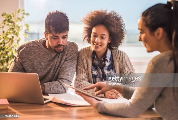 Young black couple having a meeting with their financial advisor.