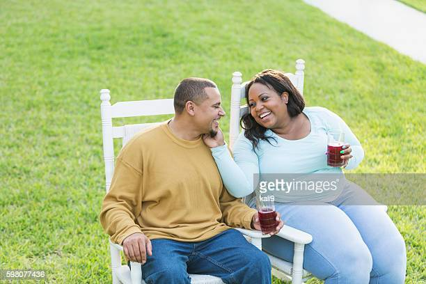 young black couple sitting, talking, drinking - images of fat black women stock photos and pictures
