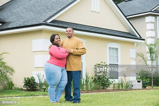 young black couple standing outside home - images of fat black women stock photos and pictures