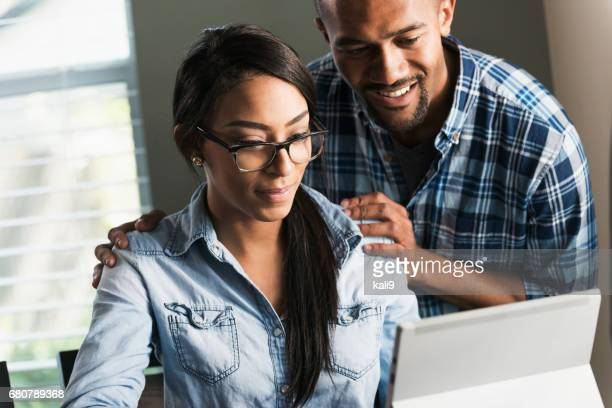 young black couple, woman on computer - minority groups stock pictures, royalty-free photos & images