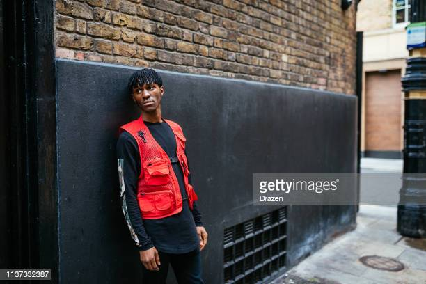 Young black fashionista man in London with Afro dreadlocks