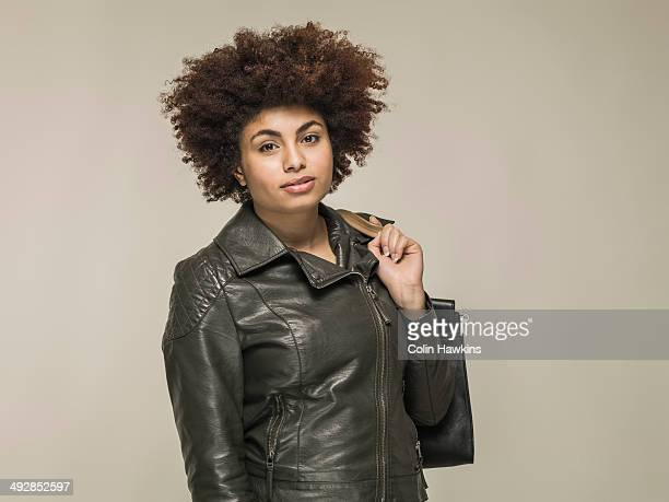 young black female with bag - leather jacket stock pictures, royalty-free photos & images