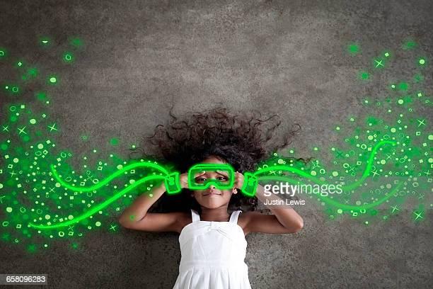 young black girl imagines an infinite universe - imagination fotografías e imágenes de stock