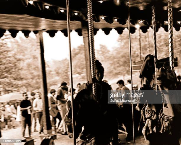 Young black girl riding the carousel at the 1st Elysian Park Love-In on March 26, 1967 in Los Angeles, California.