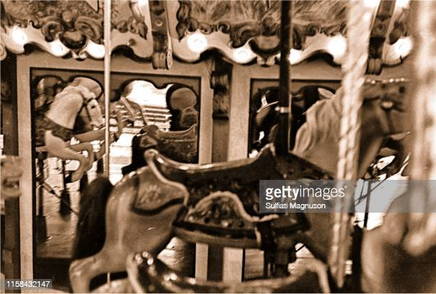 Young, black girl riding the historic carousel at the 1st Elysian Park Love-In on March 26, 1967 in Los Angeles, California.