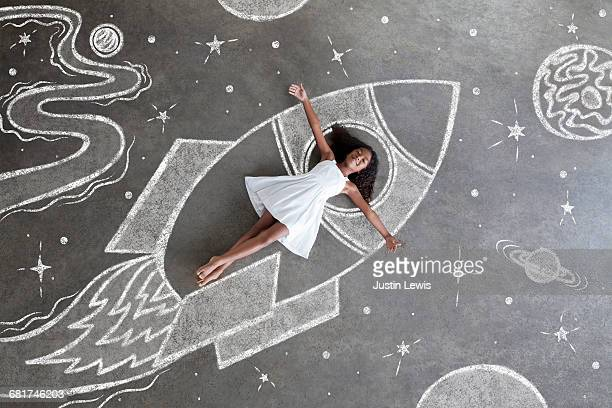 Young black girl, white dress, imaginary spaceship