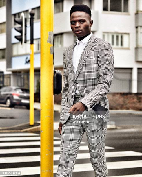 Young black man in suit walking on the streets of Cape Town