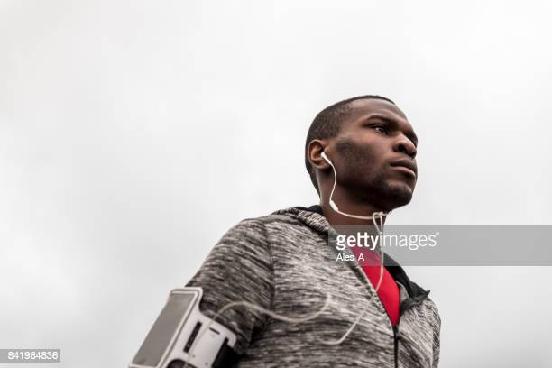 young black man running outdoors - red belt stock photos and pictures