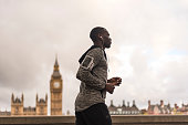Young black man running outdoors