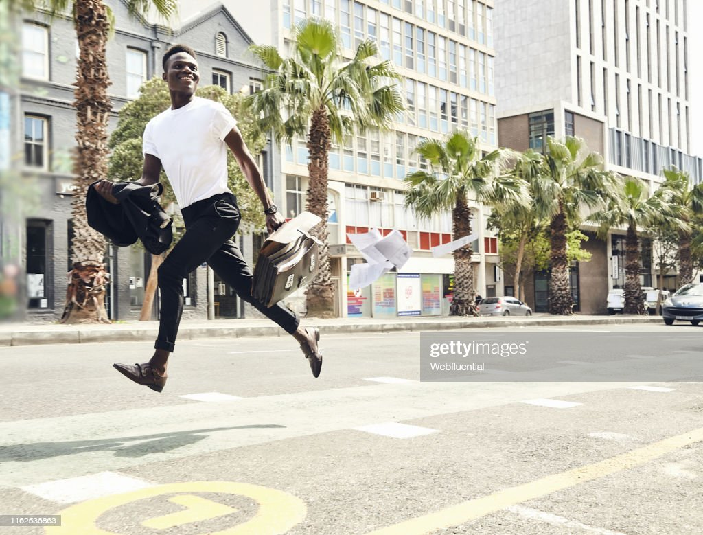 Young black man running to work : Stock Photo