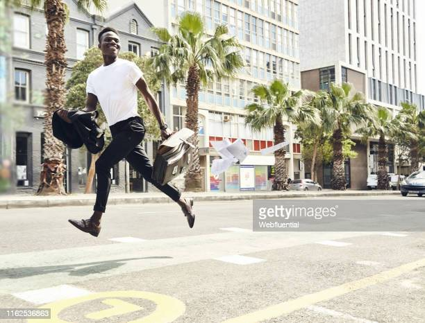 Young black man running to work