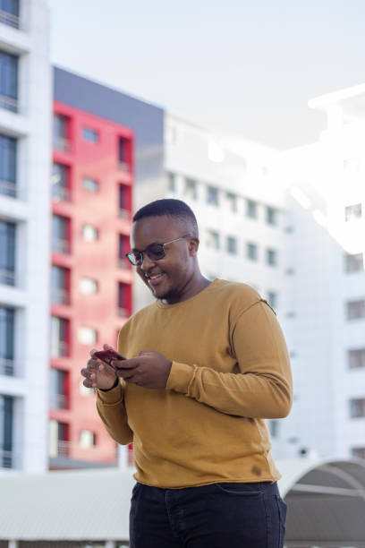 Young black man using a phone