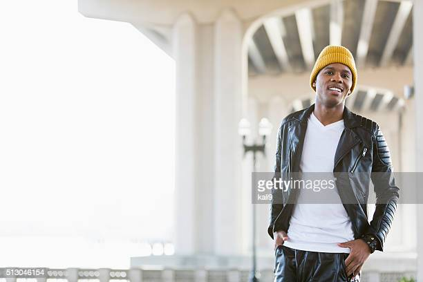 young black man wearing leather jacket and yellow cap - all hip hop models stock photos and pictures