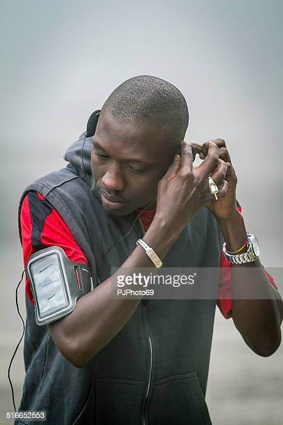 young black man with hands-free device - pjphoto69 stock pictures, royalty-free photos & images