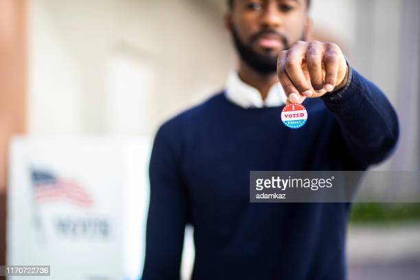 young black man with i voted sticker - democratic party usa stock pictures, royalty-free photos & images