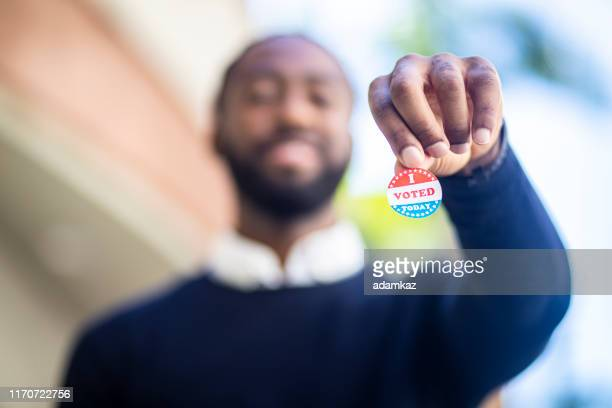 young black man with i voted sticker - presidential election stock pictures, royalty-free photos & images