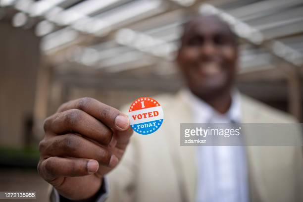 young black man with i voted sticker - midterm election stock pictures, royalty-free photos & images