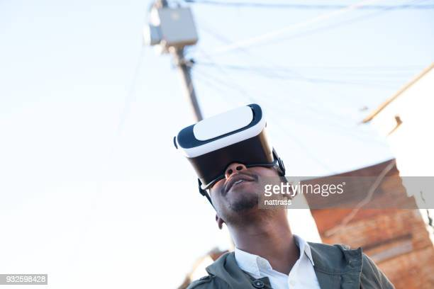 Young black man with VR goggles