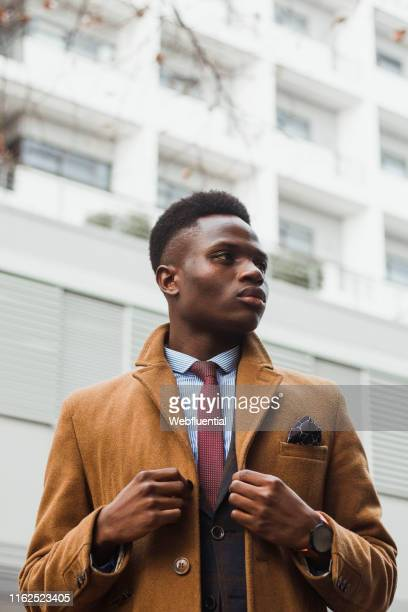 Young black South African man wearing a coat outdoors