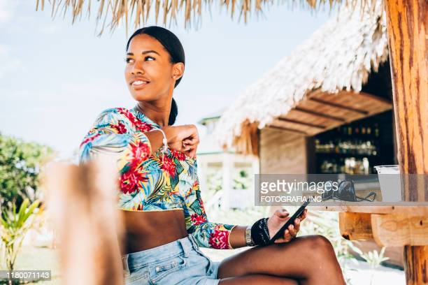 young black woman at resort cabana - caribbean stock pictures, royalty-free photos & images