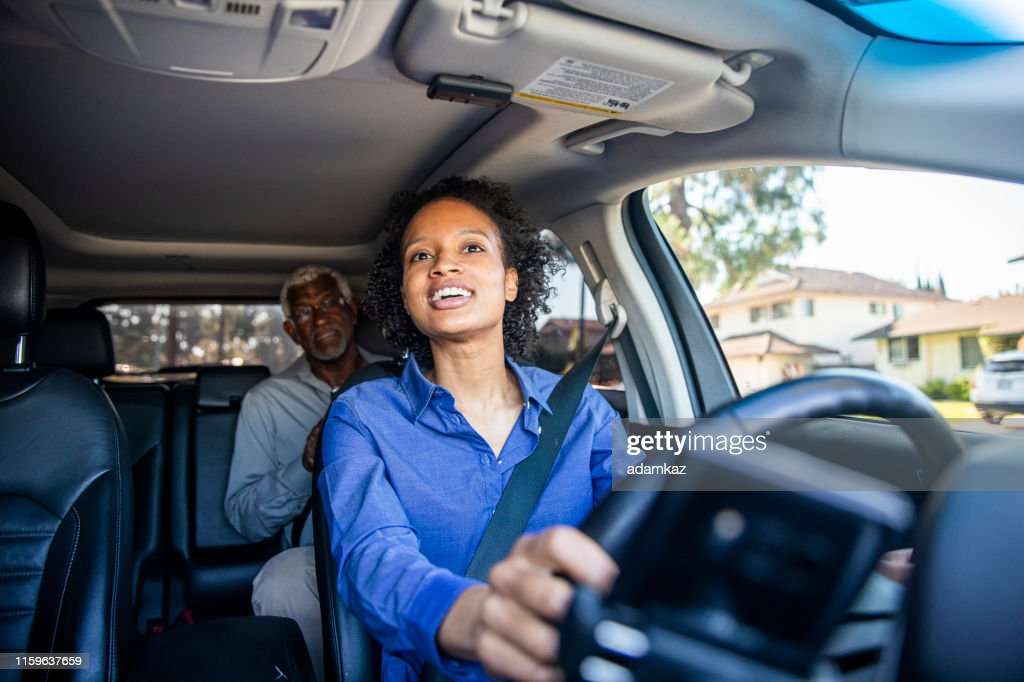 Young Black Woman Driving Car for Rideshare : Stock Photo