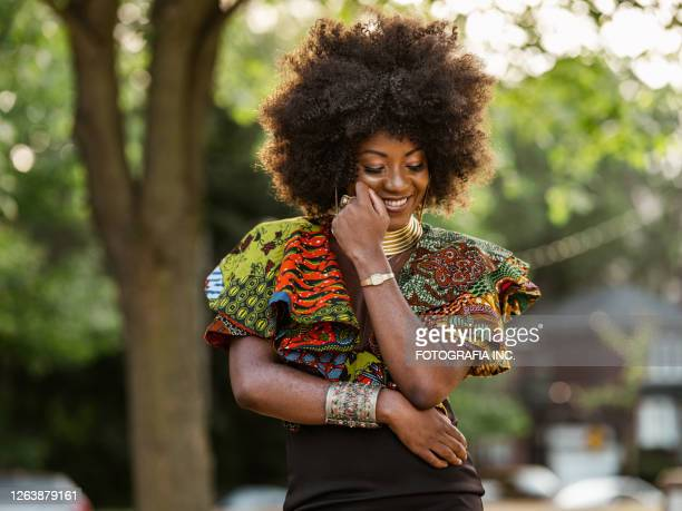 young black woman feeling groovy - afro caribbean ethnicity stock pictures, royalty-free photos & images