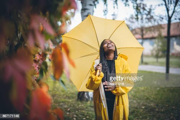 Young black woman in autumn walk through park