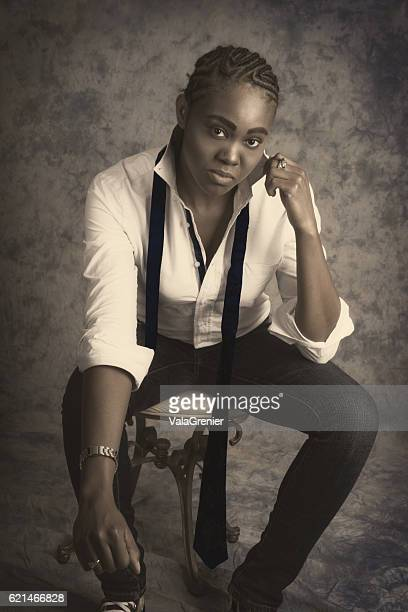 young black woman in male drag, monochrome front view, studio. - black transvestite stock pictures, royalty-free photos & images