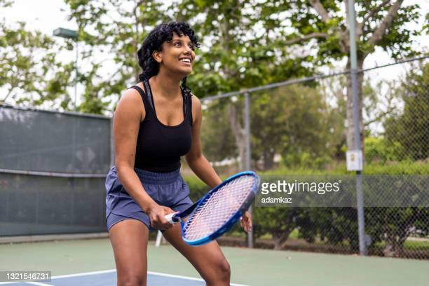 young black woman playing tennis with her friend - tennis tournament stock pictures, royalty-free photos & images